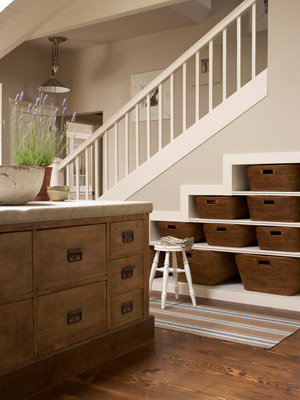Reclaim wasted space under a staircase as storage