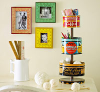 Frames on the wall made from rulers and a three tiered tin filled with craft supplies