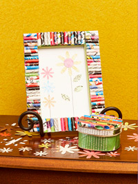 recycled magazines cut into tubes and put on frames and a tin and decoupaged
