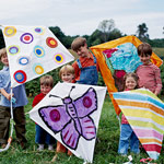 6 Kids holding kites they made.
