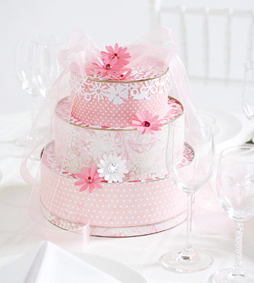 Pink wedding cake centerpiece made from tins patterned paper gems