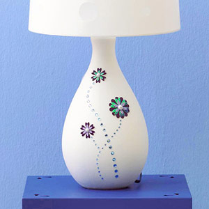 Dimensional flower stickers adhered to a lamp base
