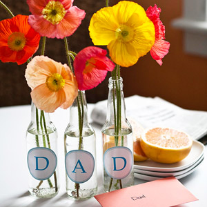 Glass bottle centerpiece for Dad