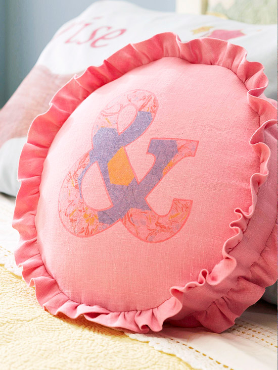 Pink round pillow with ampersand symbol