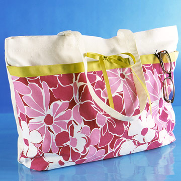 Plain tote bag embellished with fabric and ribbon