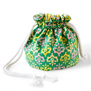 Green, pink, and yellow drawstring bag made of cotton