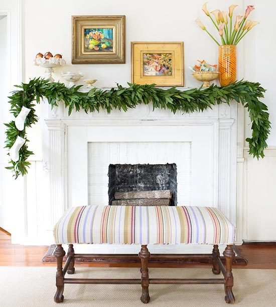 White mantel with greenery