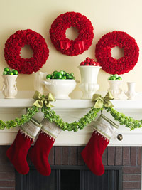 Carnation wreaths above mantel