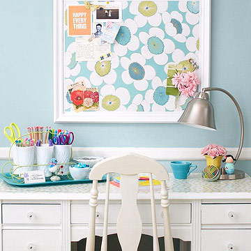 Crisp white desk with sky blue floral corkboard