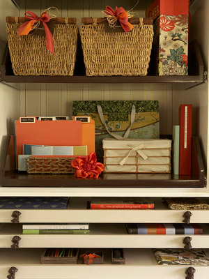 Double shelf with flat drawers beneath hold baskets and craft supplies