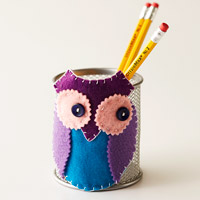 Felt shapes pieced together to create an owl accent