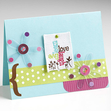 Card embellished with clear flower accents and fabric