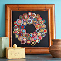 Circular fabric wreath in frame
