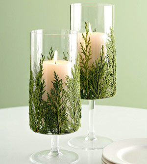 Candleholders with greenery centerpiece