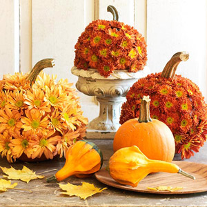 Centerpiece of pumpkins covered with mums