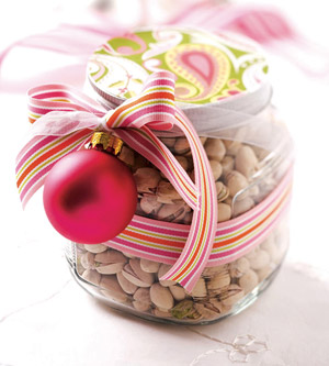 Jar with ribbon and paper-covered lid filled with nuts