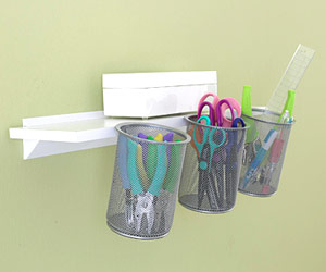 Hanging mesh cups filled with craft tools