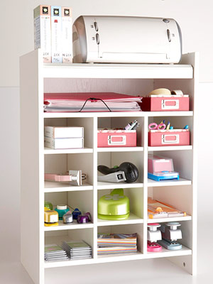 White shoe rack with cubbies filled with crafts supplies