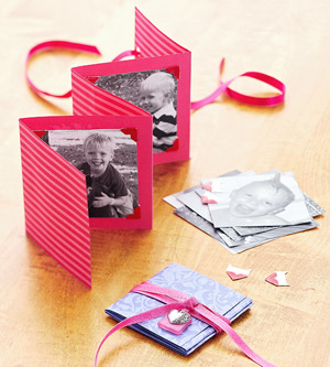 Red photo booklet made of folded card stock