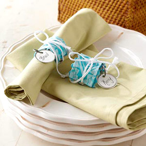 Place setting with napkins and name napkin rings