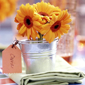 Bucket with gerbera daisies and name card attached for place card