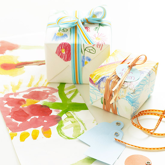 Decorated white gift wrap on presents with ribbons