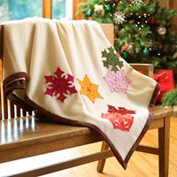 Throw embellished with bright snowflakes