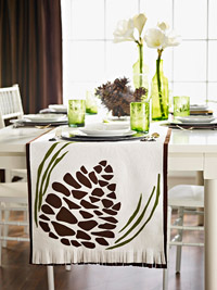 Table setting with pinecone table runner