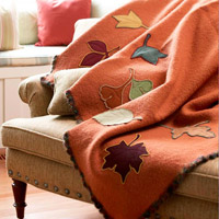 Blanket with leaf appliques