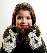 Girl with lion mittens