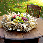 Outdoor table with cornhusk centerpiece