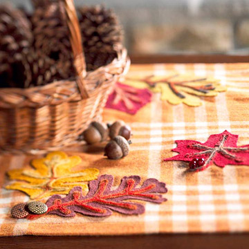 Table runner embellished with felt fall leaves