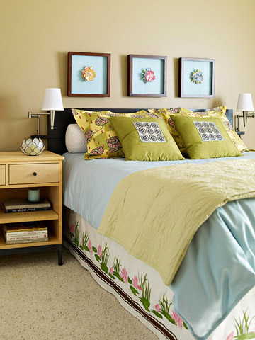 Bedroom with green and light blue linens and various lotus motifs