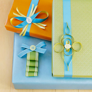 Three gifts with decorative ribbon and monogram tags