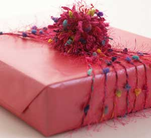 Pink wrapped gift with quirky pink yarn bow
