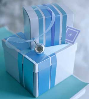 White gift boxes with blue ribbons wrapped around