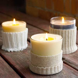 Candles with cut sweater sleeve around them