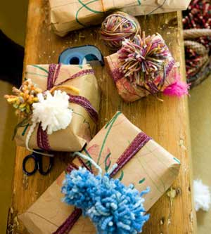 Gifts wrapped in brown paper with yarn bows