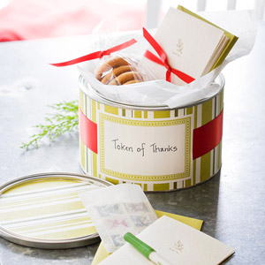 Decorative tin with cookies and note cards