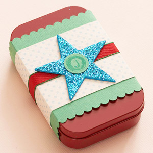 Mint tin wrapped in decorative paper with chipboard star