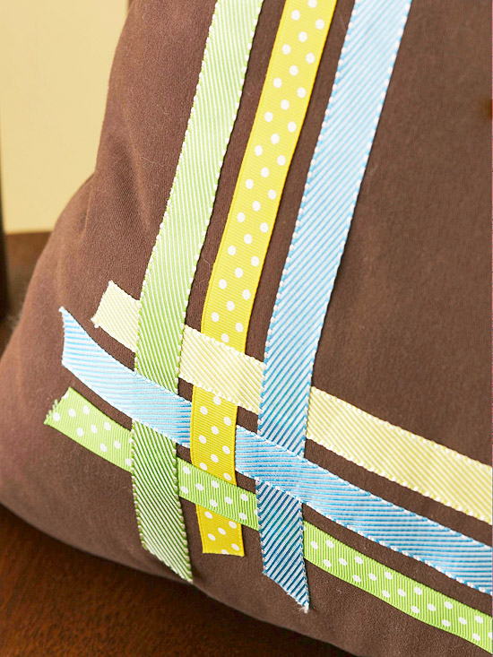 Brown pillow with closeup shot of ribbon overlapping