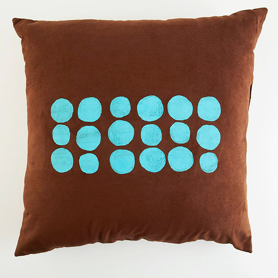 Brown pillow with screen printed blue dots