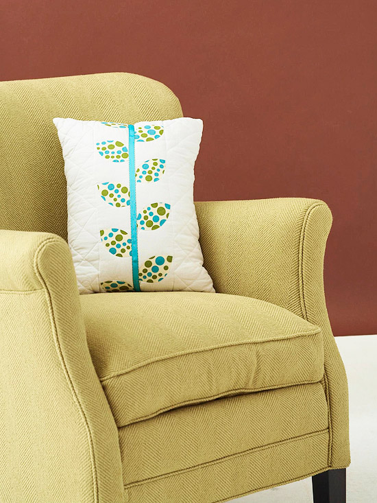White pillow with polka-dot fabric leaf pattern