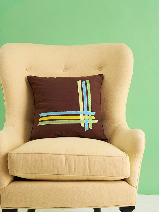 Brown pillow with colored ribbon lattice pattern