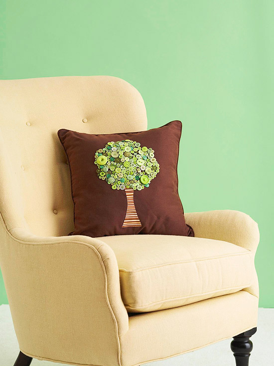 Brown pillow with green button treetop and fabric trunk