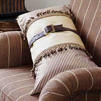 Brown pillow with brown belt cinched around the middle