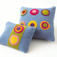 Blue felt pillows and throw with dots