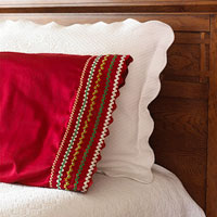 Red pillow with rickrack on edge