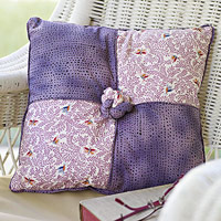 Four patch knot pillow