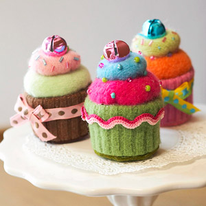 Three cupcake pincushions
